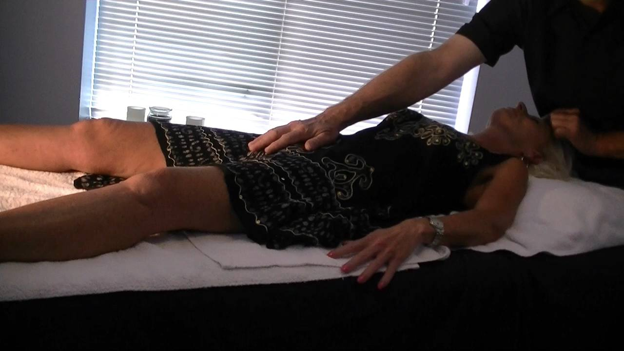 Womans massage of Pubic Mound by Male Masseur