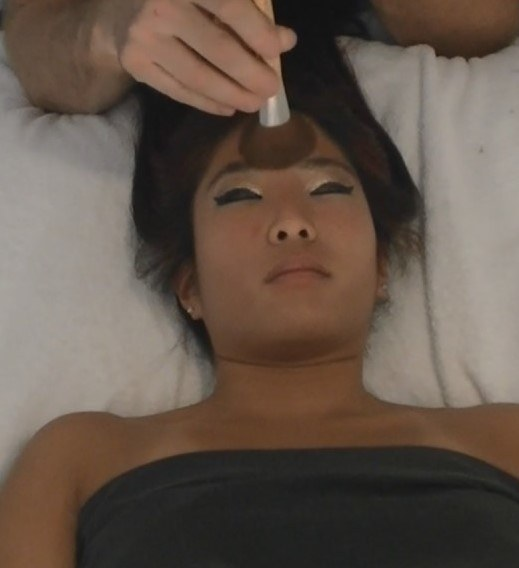 Brush on face in Sensual massage